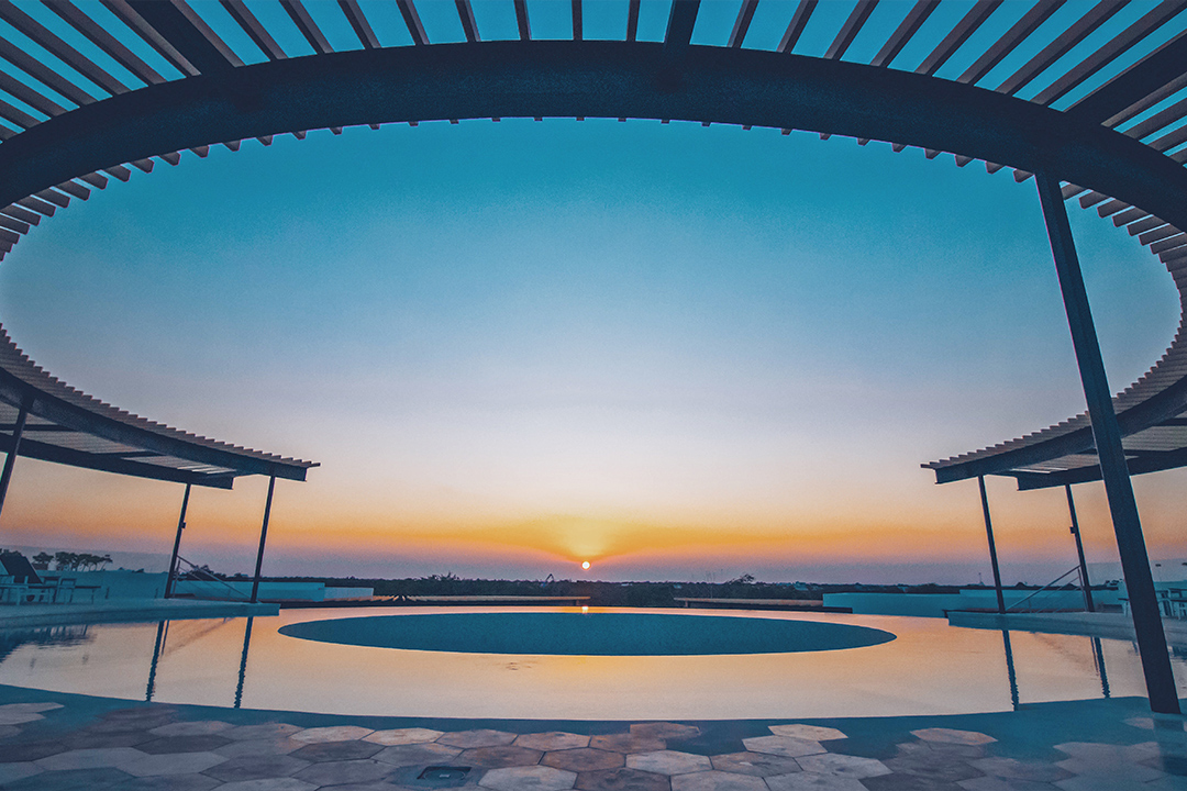 the panoramic tulum 360 infinity pool sunset